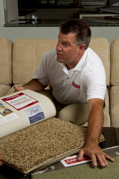 sales rep with carpet samples